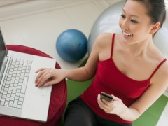 woman-exercising-near-computer